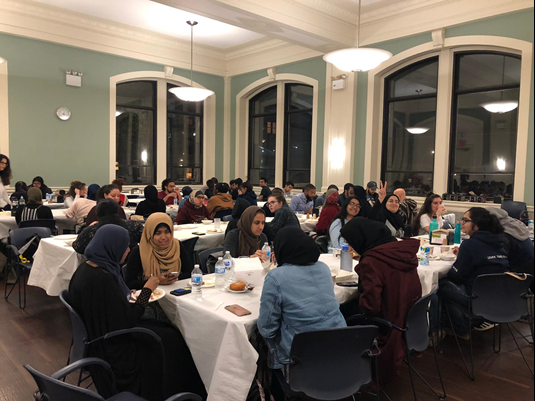 Muslim students enjoying halal food in Hewitt dining hall.