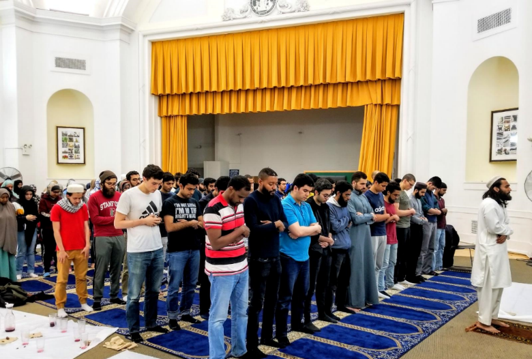 Taraweeh prayers in Earl Hall Auditorium with over 100 people.